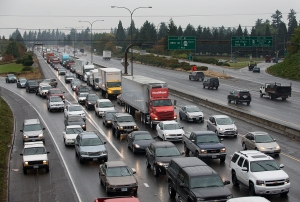 Traffic traveling southbound on Interstate 5 comes to a crawl as it makes its way through Vancouver under rainy conditions on Wednesday morning, Oct. 7, 2015. (Amanda Cowan/The Columbian)